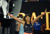 Japan's Naomi Osaka celebrates after defeating United States' Jennifer Brady in the women's singles final at the Australian Open tennis championship in Melbourne, Australia, on Feb. 20, 2021. (AP Photo/Andy Brownbill)