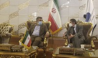Director General of International Atomic Energy Agency, IAEA, Rafael Mariano Grossi, right, speaks with spokesman of Iran's atomic agency Behrouz Kamalvandi upon his arrival at Tehran's Imam Khomeini airport, Iran, Saturday, Feb. 20, 2021. (Atomic Energy Organization of Iran via AP)