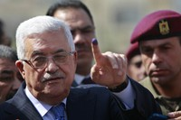 In this Saturday, Oct. 20, 2012 file photo, palestinian President Mahmoud Abbas shows his ink-stained finger after casting his vote during local elections at a polling station in the West Bank city of Ramallah. (AP Photo/Majdi Mohammed, File)