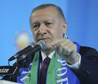 Turkish President Recep Tayyip Erdogan addresses his ruling party's supporters in the Black Sea city of Rize, Turkey, Monday, Feb. 15, 2021. (Turkish Presidency via AP, Pool)
