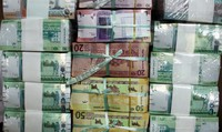 In this July 24, 2011, file photo, Sudan's new currency sits behind a window at the central bank in Khartoum, Sudan. (AP Photo/Abd Raouf, File)