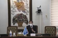 Director General of International Atomic Energy Agency, IAEA, Rafael Mariano Grossi speaks in a meeting with Iran's atomic chief Ali Akbar Salehi in Tehran, Iran, Sunday, Feb. 21, 2021. (Atomic Energy Organization of Iran via AP)
