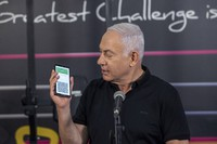 Israeli Prime Minister Benjamin Netanyahu talks to the media during a visit to the Fitness gym ahead of the re-opening of the branch in Petah Tikva, Israel, on Saturday, Feb. 20, 2021. (AP Photo/Tal Shahar, Yediot Ahronot, Pool)