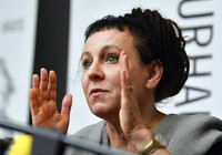 In this Oct. 11, 2019 file photo, Polish writer and Nobel Prize winner Olga Tokarczuk reacts to the media during a press conference in Duesseldorf, Germany. (AP Photo/Martin Meissner)
