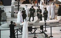 A military delegation visits the display of Halcon, a regional leader in the end-to-end manufacturing of precision-guided systems, during the opening day of the International Defence Exhibition & Conference, IDEX, in Abu Dhabi, United Arab Emirates, on Feb. 21, 2021. (AP Photo/Kamran Jebreili)