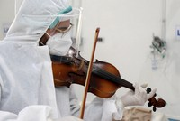 Dr. Mohamed Salah Siala plays the violin for patients on the COVID wards of the Hedi Chaker hospital in Sfax, eastern Tunisia, on Feb. 20, 2021. (AP Photo)