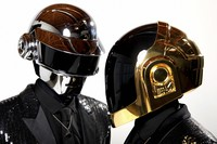 In this April 17, 2013 file photo, Thomas Bangalter, left, and Guy-Manuel de Homem-Christo, from the music group, Daft Punk, pose for a portrait in Los Angeles. (Photo by Matt Sayles/Invision/AP)