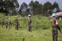 United Nations peacekeepers guard the area where a U.N. convoy was attacked and the Italian ambassador to Congo killed, in Nyiragongo, North Kivu province, Congo, on Feb. 22, 2021. (AP Photo/Justin Makangara)