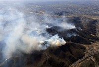 This photo taken from a Mainichi Shimbun helicopter shows the effects of four days of wildfires that have been burning in a mountain forest in Ashikaga, Tochigi Prefecture, on Feb. 24, 2021. (Mainichi/Daiki Takikawa)