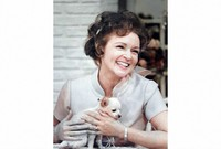 "This colorized image released by Margate And Chandler, Inc. shows actress and animal activist Betty White with a puppy from her 1970s series ""The Pet Set"". (Margate And Chandler, Inc. via AP)"
