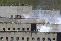 Tear gas rises from parts of Turi jail where an inmate riot broke out in Cuenca, Ecuador, on Feb. 23, 2021. (AP Photo/Marcelo Suquilanda)
