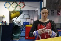 Former gymnastics world champion and Olympic silver medalist Chellsie Memmel works out on Feb. 18, 2021, in New Berlin, Wisc. The 32-year-old married mother of two is making an unlikely comeback. (AP Photo/Morry Gash)