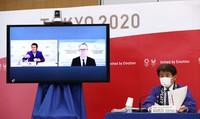 Hidemasa Nakamura, right, games delivery officer at the Tokyo Organising Committee of the Olympic and Paralympic Games, is seen announcing guidelines for preventing coronavirus infections ahead of the Tokyo Games, in the capital's Chuo Ward on Feb. 3, 2021. (Pool photo)