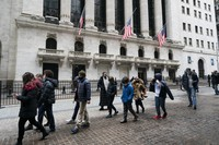 A school group walks by the New York Stock Exchange on Feb. 23, 2021. (AP Photo/Mark Lennihan)