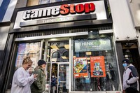 In this Jan. 28, 2021 file photo, pedestrians pass a GameStop store on 14th Street at Union Square, in the Manhattan borough of New York. (AP Photo/John Minchillo)