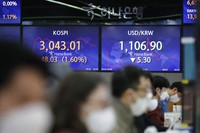 Screens showing the Korea Composite Stock Price Index (KOSPI), left, and the foreign exchange rate between the U.S. dollar and South Korean won are seen at the foreign exchange dealing room in Seoul, South Korea, on Feb. 25, 2021. (AP Photo/Lee Jin-man)