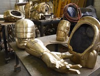 In this Sept. 19, 2017, file photo, body parts for a RoboCop statue are displayed in sculptor conservator Giorgio Gikas' studio in Detroit. (Clarence Tabb Jr./Detroit News via AP)