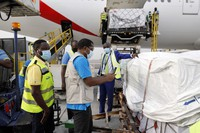 This photo released by UNICEF on Feb. 24, 2021, shows the first shipment of COVID-19 vaccines distributed by the COVAX Facility arriving at Kotoka International Airport in Accra, Ghana. (Francis Kokoroko/UNICEF via AP)