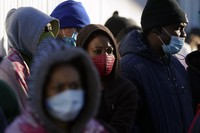 Asylum seekers wait for news of policy changes at the border on Feb. 19, 2021, in Tijuana, Mexico. (AP Photo/Gregory Bull)