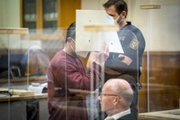 Syrian defendant Eyad Al-Gharib hides his face as he arrives to hear his verdict in a court room in Koblenz, Germany, on Feb. 24, 2021. (Thomas Lohnes/Pool Photo via AP)
