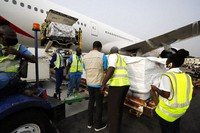 This photograph released by UNICEF on Feb. 24, 2021 shows the first shipment of COVID-19 vaccines distributed by the COVAX Facility arriving at the Kotoka International Airport in Accra, Ghana. (Francis Kokoroko/UNICEF via AP)
