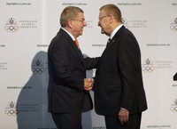 In this May 4, 2019 file photo, International Olympic Committee President Thomas Bach, left, shakes hands with Australian Olympic Committee (AOC) President John Coates at the AOC annual general meeting in Sydney, Australia. (AP Photo/Rick Rycroft)