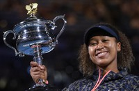 Japan's Naomi Osaka holds the Daphne Akhurst Memorial Cup aloft after defeating United States Jennifer Brady in the women's singles final at the Australian Open tennis championship in Melbourne, Australia, on Feb. 20, 2021. (AP Photo/Andy Brownbill)