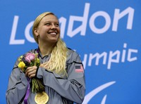 In this Sept. 1, 2012 file photo, Jessica Long of the United States poses with her gold medal during the medal ceremony for the women's 100-meter breaststroke SB7 at the 2012 Paralympics game in London.  (AP Photo/Alastair Grant)