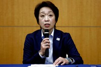 President of the Tokyo 2020 Olympics Organizing Committee Seiko Hashimoto speaks during a press briefing on the operation and media coverage of the Tokyo 2020 Olympic Torch Relay in Tokyo on Feb. 25, 2021. (Behrouz Mehri/Pool Photo via AP)