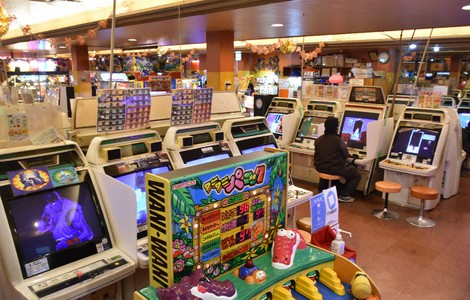 "This photo shows the interior of Kasuga Amusement Arcade in Osaka's Naniwa Ward on Jan. 20, 2021. In the foreground is ""Gator Panic,"" a game similar to ""Whac-a-Mole."" (Mainichi/Hitoshi Sonobe)"