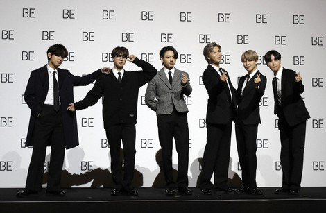 "In this Nov.20, 2020 file photo, members of South Korean K-pop band BTS pose for photographers during a press conference to introduce their new album ""BE"" in Seoul, South Korea. (AP Photo/Lee Jin-Man, file)"