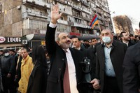 Armenian Prime Minister Nikol Pashinyan waves to supporters during a rally in his support in the center of Yerevan, Armenia, on Feb. 25, 2021. (Tigran Mehrabyan/PAN Photo via AP)