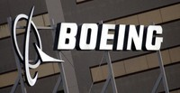 In this Jan. 25, 2011 file photo, the Boeing Company logo on the property in El Segundo, Calif. (AP Photo/Reed Saxon)