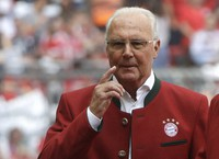 In this May 20, 2017 file photo, Bayern legend Franz Beckenbauer stands on the pitch prior to the German first division Bundesliga soccer match against SC Freiburg in Munich, Germany. (AP Photo/Matthias Schrader)