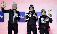 From left, Norway's silver medalist Maren Lundby, Slovenia's gold medalist Ema Klinec and Japan's bronze medalist Sara Takanashi celebrate during the medal ceremony for the women's ski jumping normal hill individual final round at the FIS Nordic World Ski Championships in Oberstdorf, Germany, on Feb. 25, 2021. (AP Photo/Matthias Schrader)