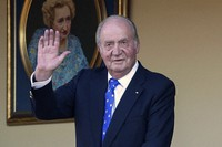In this June 2, 2019 file photo, Spain's former King Juan Carlos waves during a bullfight at the bullring in Aranjuez, Madrid, Spain. (AP Photo/Andrea Comas)
