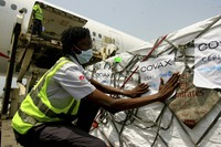 A shipment of COVID-19 vaccines distributed by the COVAX Facility arrives in Abidjan, Ivory Coast, on Feb. 25, 2021. (AP Photo/ Diomande Ble Blonde)