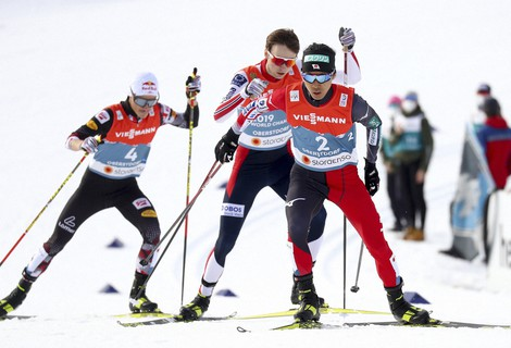 Japan's Akito Watabe, front, competes during the men's individual gundersen NH/10km competition at the FIS Nordic World Ski Championships in Oberstdorf, Germany, on Feb. 26, 2021. (AP Photo/Matthias Schrader)