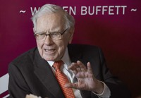 In this May 5, 2019, file photo Warren Buffett, Chairman and CEO of Berkshire Hathaway, speaks during a game of bridge following the annual Berkshire Hathaway shareholders meeting in Omaha, Neb. (AP Photo/Nati Harnik, File)