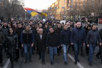 Opposition demonstrators march to the government buildings during a rally to pressure Armenian Prime Minister Nikol Pashinyan to resign in Yerevan, Armenia, Saturday, Feb. 27, 2021.