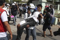 A wounded protester is carried during a protest against the military coup in Mandalay, Myanmar, on Feb. 28, 2021. (AP Photo)