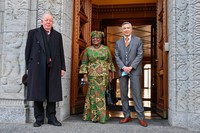 New Director-General of the World Trade Organisation Ngozi Okonjo-Iweala, center, poses between WTO Deputy Directors-General Alan Wolff, left, and Karl Brauner upon her arrival at the WTO headquarters to takes office in Geneva, Switzerland, Monday, March 1, 2021. (Fabrice Coffrini/Pool/Keystone via AP)