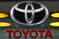 In this Sept. 20, 2017 file photo, the Toyota logo is displayed at their shop on the Champs Elysees Avenue in Paris. (AP Photo/Francois Mori)