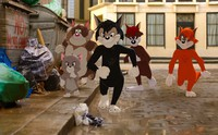 """This image shows Butch, leader of the alley cats, foreground center, voiced by Nicky Jam, in a scene from the animated/live-action film """"Tom & Jerry."""" (Warner Bros. Pictures via AP)"""
