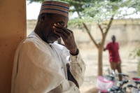 Father Aliyu Ladan Jangebe, whose four daughters are among more than 300 girls who were abducted by gunmen on Friday from the Government Girls Junior Secondary School, waits for news in Jangebe town, Zamfara state, northern Nigeria, on Sunday, Feb. 28, 2021. (AP Photo/Ibrahim Mansur)