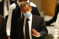Former French President Nicolas Sarkozy arrives at the courtroom, on March 1, 2021 in Paris. (AP Photo/Michel Euler)