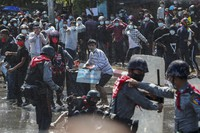 Protesters run after police fired warning shots and used water cannons to disperse them during a protest in Mandalay, Myanmar, Tuesday, Feb. 9, 2021. (AP Photo)