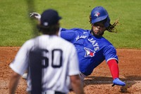 New York Yankees' Asher Wojciechowski (60) watches as Toronto Blue Jays' Vladimir Guerrero Jr. scores on a Jonathan Davis single during the third inning of a spring baseball game, on Feb. 28, 2021, in Tampa, Fla. (AP Photo/Frank Franklin II)