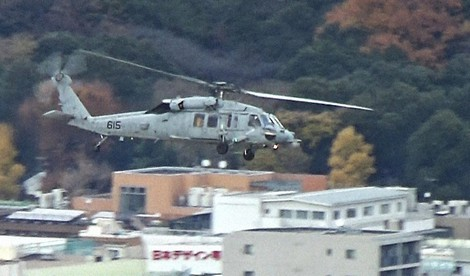 A U.S. Navy Seahawk helicopter is seen entering the zone within the Yamanote loop line from above an area near JR Harajuku Station in Tokyo's Shibuya Ward, in this image from video taken on Dec. 14, 2020. (Mainichi/Hiroyuki Oba)