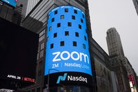 This April 18, 2019 file photo shows a sign for Zoom Video Communications ahead of the company's Nasdaq IPO in New York. (AP Photo/Mark Lennihan)